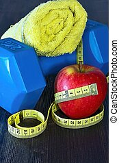 The equipment needed for fitness on board. Dumbbell and snacks.