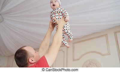 Father Playing With Baby Son At Home - Happy Father Playing...