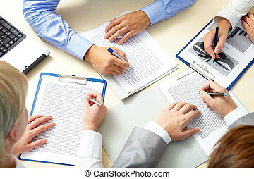 Paperwork - Image of business people hands working with...