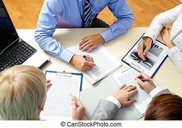 Meeting - Image of business people working with documents at...