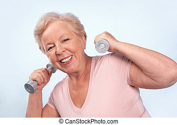Fitness - Portrait of aged female doing physical exercise...