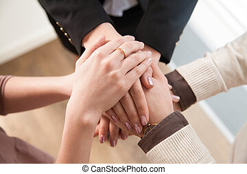 Top view of business team showing unity with hands together...