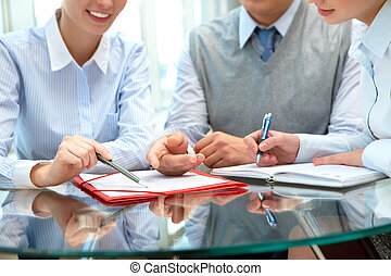 Sharing ideas - Image of business people sharing ideas round...