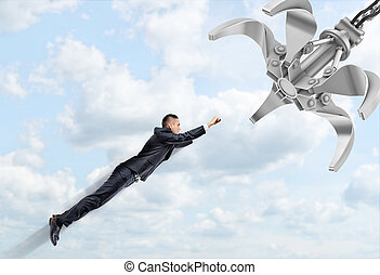 A businessman flying through the clouds ready to face a...