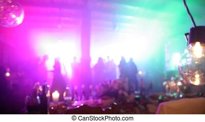A cheerful crowd is dancing at a party .