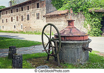 Old well covered with hand pump. It needed around the...