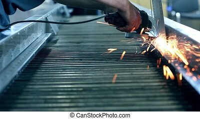 Sparks from grinder at workshop