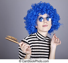 Coquette blue-hair girl with comb. Studio shot.