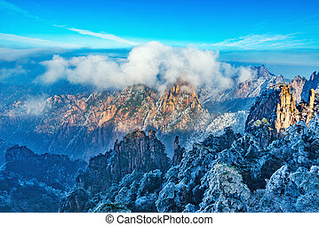 Huangshan National park. - Clouds above the peaks of...