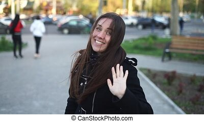 Pretty urban girl waving hand saying hello and hi gesture....