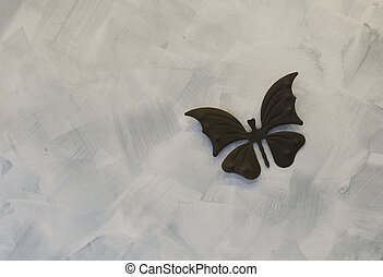 Iron butterfly on cement background