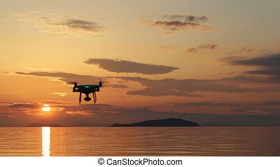 Drone flying with sunset sky - Drone quad copter with flying...