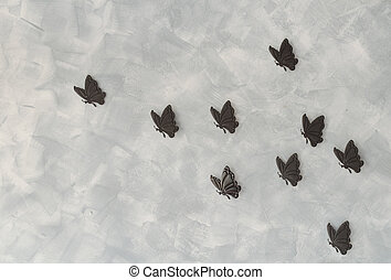 Iron butterflys on cement background