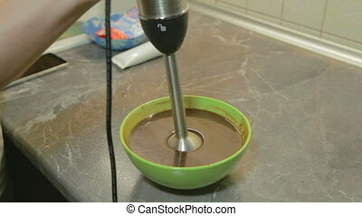 Mixing chocolate glaze in blender, shooting in the kitchen
