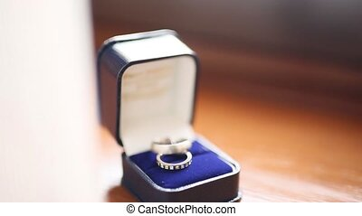 Wedding rings in blue box for the ring. Wedding jewelry.