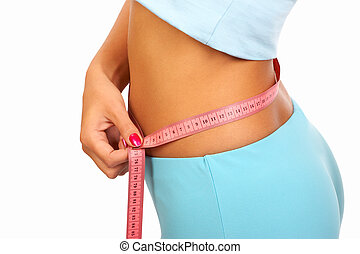 Waistline - Young sexy woman measuring her waist. Isolated...