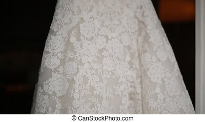Bride's dress, close-up. Details of the wedding dress of the...