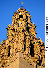 Cathedral - A well lit and ornate cathedral tower stands...