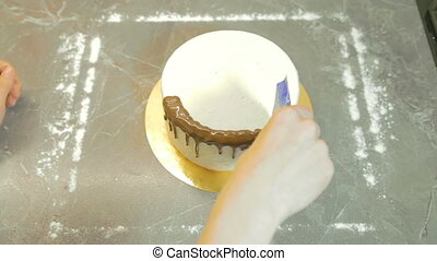 Decorating chocolate glaze for cake, shooting in the kitchen