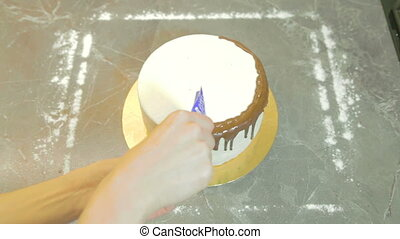 Decorating chocolate glaze for dessert, shooting in the...