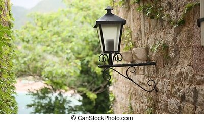 Vintage lamp on the wall on the street. - Vintage lamp on...