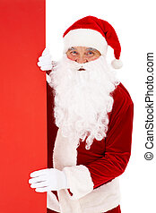 Peeking Santa - Photo of happy Santa Claus peeking out of...