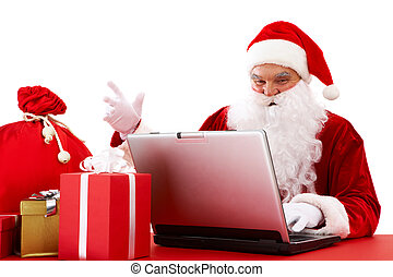 Sending xmas e-mail - Portrait of Santa Claus in front of...