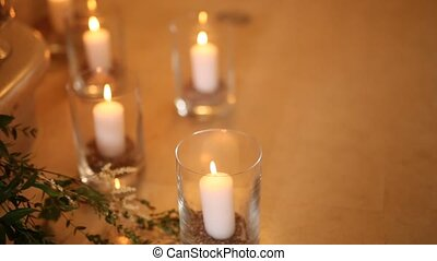 Candles in glass lamps. Wedding decorations. Wedding in...