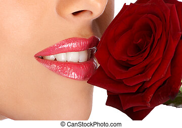 aroma - Young pretty woman holding and smelling red rose