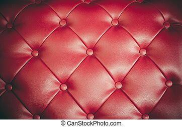 Red leather sofa backrest.