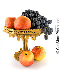 fruits in woodem vase on white background