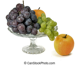 fruits in glass vase on white background