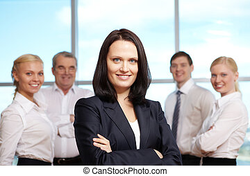 Successful leader - Portrait of pretty female looking at...
