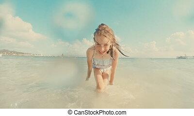 Little girl having fun in the sea.