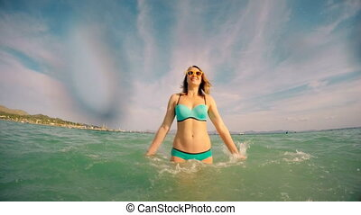 Woman enjoying her vacation in the sea.