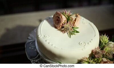 Wedding cake with flowers. Wedding at the sea