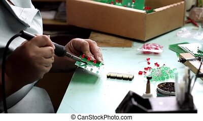 Woman hands solder components - Manual solder PCB electronic...