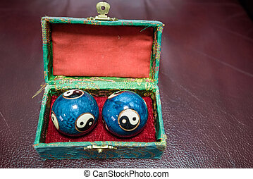 Closeup of blue Chinese Baoding balls in box - Closeup of...