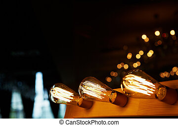 Edison light bulb hanging on a long wire. Cozy warm yellow light.Retro