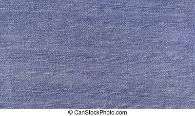 Close-up of rotation denim texture . View from above