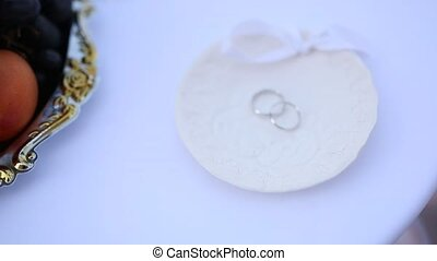 Wedding rings on a plate for rings on the table for...