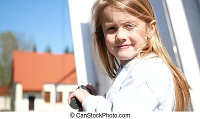 Close up portrait of little blond girl.