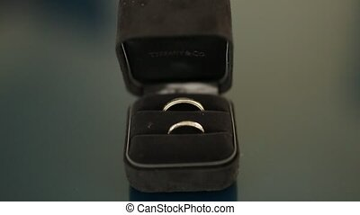 Wedding rings in a black box for rings. Wedding jewelry.