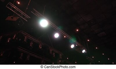 Lighting at the concert. Stage lights. Disco ball. Searchlights.