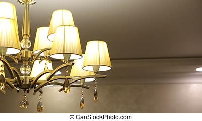 Golden Chandelier In The Restaurant. - Golden Chandelier In...