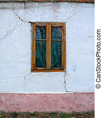 Window - Old wooden window on the wall of an old house in...