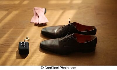 Men shoes and bow tie. Wedding accessories and groom clothes...