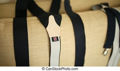 men's suspenders lying on the couch (sofa)
