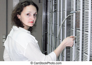 Woman working on telecommunication equipment - Woman working...