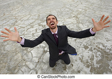 Crying - Photo of crying businessman standing on dry ground...